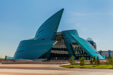 The Central Concert Hall Kazakhstan on a background of clouds