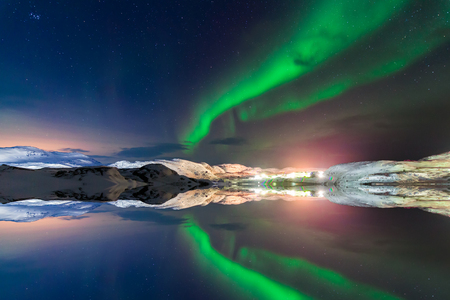 Northern lights above the fjord in Norway