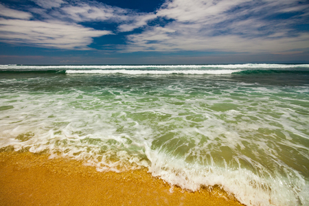 Bali seascape with huge waves at beautiful hidden white sand beach. Stock Photo