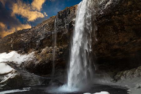 Beautiful Seljalandsfoss waterfall. Iceland. Winter view at dawn Stock Photo