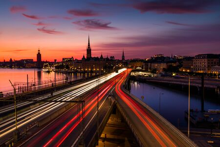 Scenic view of old buildings and car traffic at the bridge Stockholm, Sweden. Stock Photo - 129845598