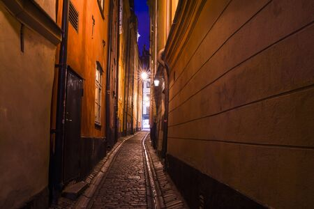 The narrow cobblestone street with houses of Gamla Stan old center of Stockholm Stock Photo