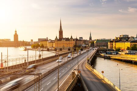 Scenic view of old buildings and car traffic at the bridge Stockholm, Sweden. Stock Photo - 129845599