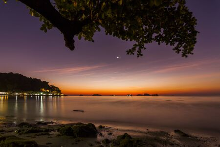 Romantic Evening on a tropical island with night illumination.