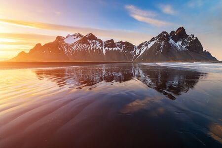 Sunset at Vestrahorn Mountain and Stokksnes beach. Iceland Stok Fotoğraf