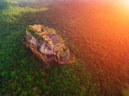 Aerial view of Sigiriya rock at misty morning, Sri Lanka. Drone footage