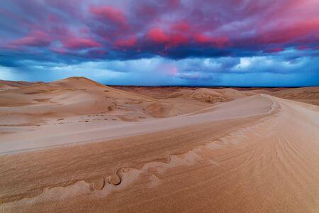 Dramatic sunset over sand dunes in the desert Stock fotó
