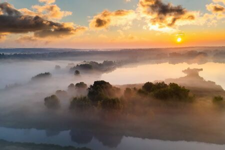 Beautiful misty dawn in the spring on the river. Aerial view