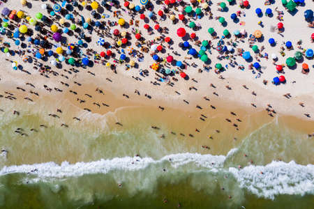 Aerial view of Copacabana beach with beach umbrellas and sun loungers . Rio de Janeiro, Brazil.