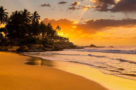 Beautiful sunset on the beach in a tropical resort in the Philippines