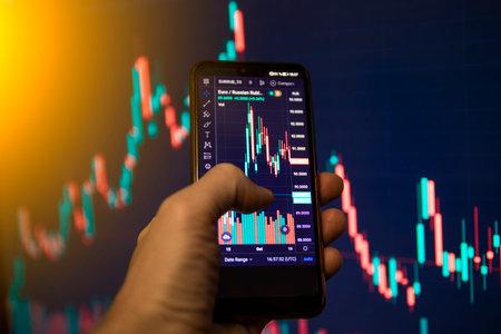 Man analyse stock market using mobile smart phone