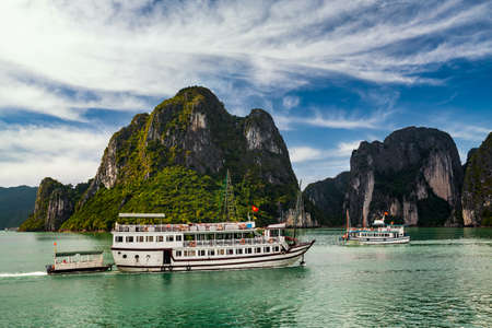 View of ships and islands in Halong Bay at sunset, Vietnam.