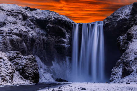 The famous Skogafoss waterfall in the winter at dawn. One of the most popular places in Iceland