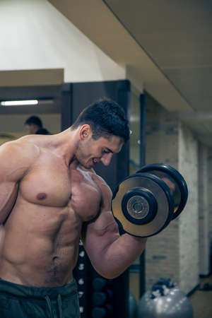 strong: strong young man trains hands Stock Photo