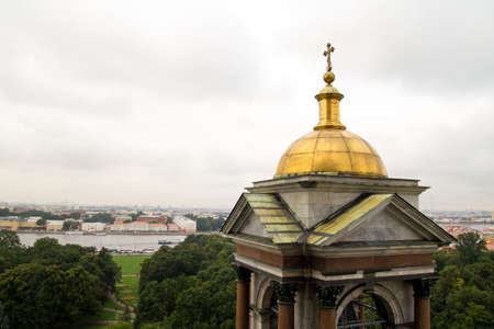 The golden dome of the Orthodox Cathedral under the cloudy sky