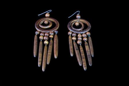 wooden handmade: Beautiful elegant wooden handmade earrings on a black background