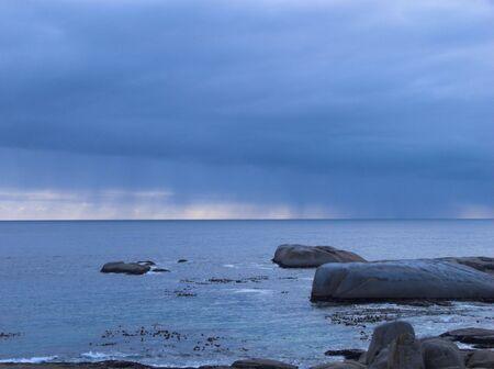 seascape with rain on the horizon Stock Photo