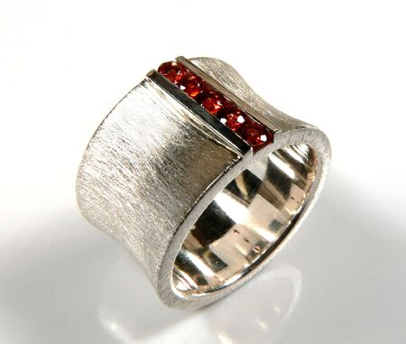 Ring with round red garnets channel set in in white gold