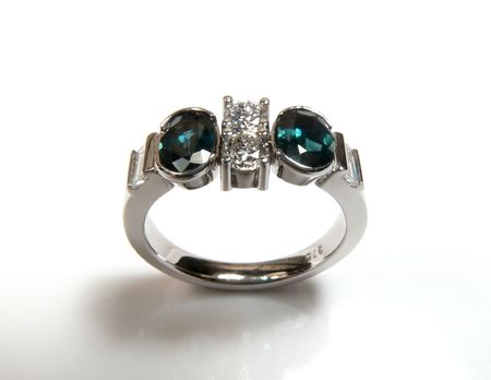 Diamond ring with green saphires set in 9ct white gold