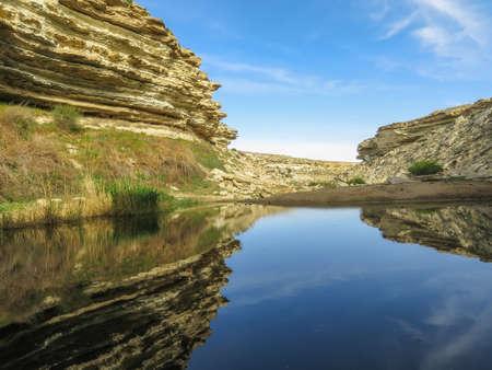 Blue lake in the desert among the rocks. Nature landscape