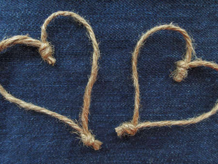 Sign two hearts of twine in denim