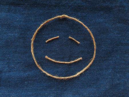 Funny smiley of twine in denim Zdjęcie Seryjne