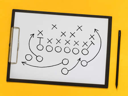 American football strategy, coaching, training. Game strategy. Scheme of the game on a sheet of paper Stock Photo