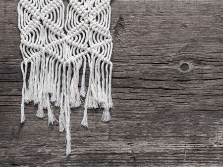 Macrame.  White thread, wooden background, closeup Stok Fotoğraf