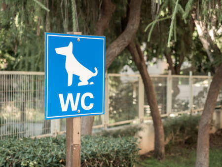 Dog toilet sign in a city park. Animal care. Close-up