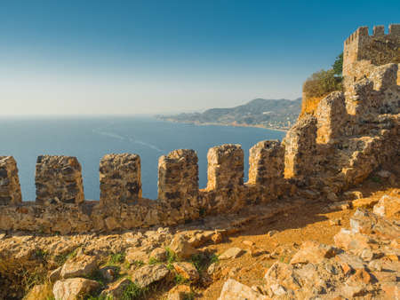 Alanya, Turkey. Beautiful view from the fortress Alanya Castle of the Mediterranean Sea and Cleopatra beach at sunset. Vacation postcard background Banque d'images