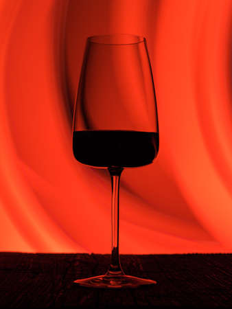 Wine glass on a dark colored background. Glare in the glass, minimalistic beautiful concept. Фото со стока - 137089477