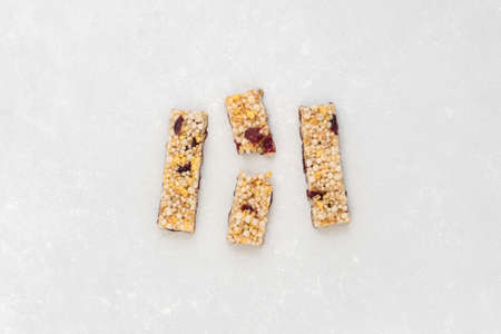 Anti-aging snacks, healthy food. Snack products with anti-aging ingredients. Whole-cereal fitness bar Фото со стока - 137943415
