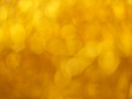 Gold bokeh. Yellow beautiful festive abstract background. Blurry light. Фото со стока - 138179303