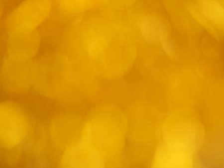 Gold bokeh. Yellow beautiful festive abstract background. Blurry light. Фото со стока - 138179565