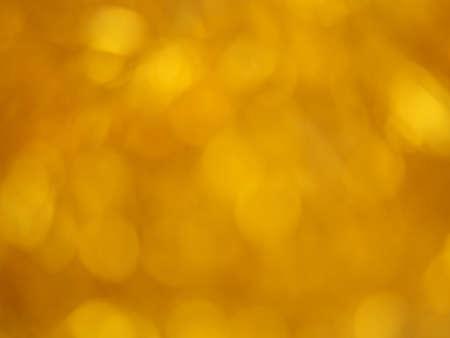 Gold bokeh. Yellow beautiful festive abstract background. Blurry light. Фото со стока - 138180209