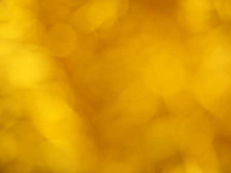 Gold bokeh. Yellow beautiful festive abstract background. Blurry light. Фото со стока - 138180199