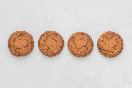 Healthy oatmeal cookies lie on a white background. Top view, copy space.