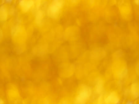 Gold bokeh. Yellow festive abstract background. Blurry light