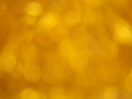 Gold bokeh. Yellow beautiful festive abstract background. Blurry light. Stok Fotoğraf