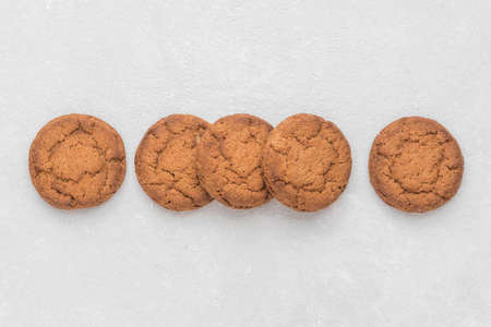 Healthy oatmeal cookies lie on a white background. Top view, copy space