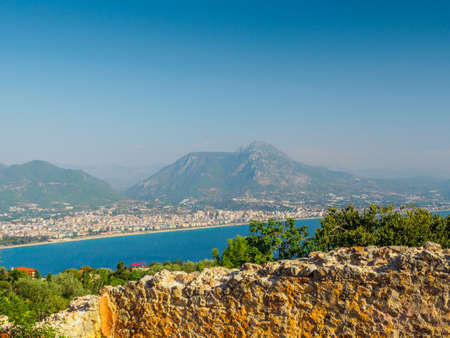 Alanya, Turkey. Beautiful view from the fortress Alanya Castle of the Mediterranean Sea and beach at sunset. Vacation postcard background 写真素材