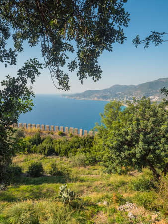 Alanya, Turkey. Beautiful view from the fortress Alanya Castle of the Mediterranean Sea and Cleopatra beach at sunset. Vacation postcard background 写真素材