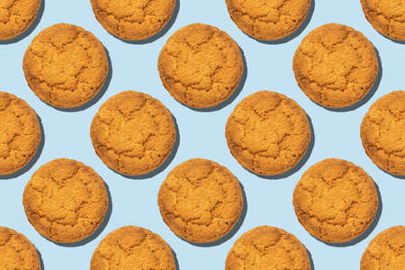 Healthy oatmeal cookies seamless trend pattern isolated on blue background. Top view