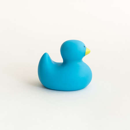 Toy blue rubber duck isolated on white background. Фото со стока