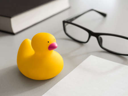 Toy yellow rubber duck on the desktop. Opposition symbol and political struggle.