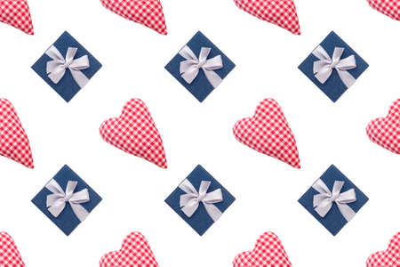 Christmas seamless pattern. Top view soft red heart pads and blue gift box on white background. Love concept flat lay