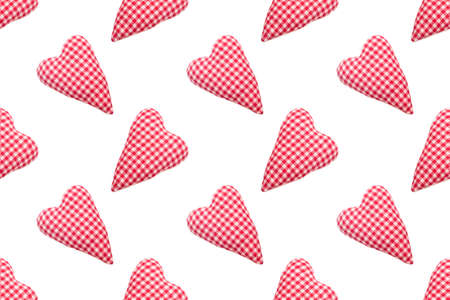Christmas seamless pattern. Top view soft red heart pads on white background. Love concept flat lay