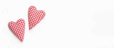 Valentines day banner. Two soft red hearts on white background. Flat lay composition. Top view, copy space Фото со стока
