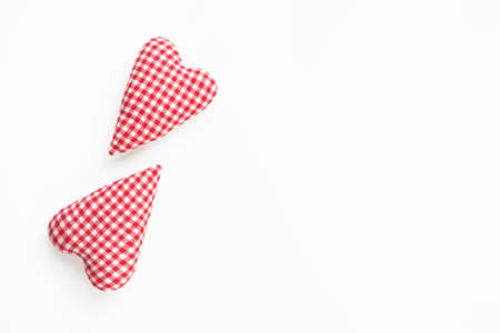 Valentines day composition. Two soft red hearts on white background. Flat lay, top view, copy space