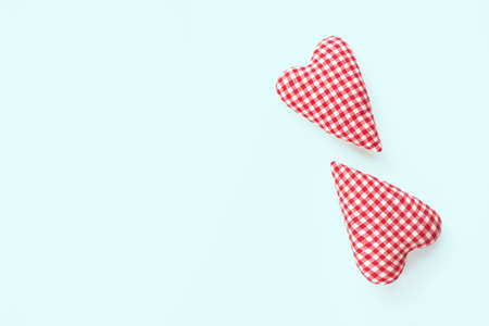 Valentines day composition. Two soft red hearts on pastel blue background. Flat lay, top view, copy space